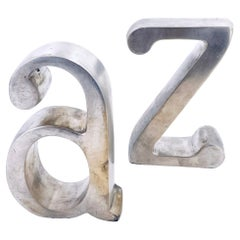 """Pair of """"A to Z"""" Bookends in the Style of Curtis Jere in Brushed Steel"""