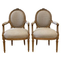 Antique Pair of Gilt Wood Open Arm Chairs Upholstered in Natural Linen
