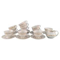 Royal Doulton, England, Twelve Fairfax Teacups with Saucers and a Cream Jug