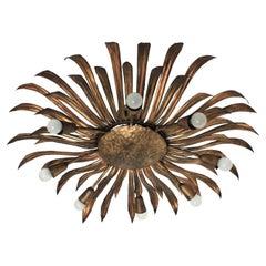 Huge Sunburst Flower Ceiling Light Fixture or Chandelier in Gilt Iron