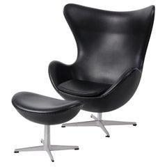Arne Jacobsen Black Egg Chair and Footstool by Fritz Hansen in Denmark