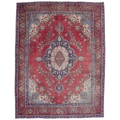 Distressed Antique Persian Tabriz Rug with Rustic English Manor House Style