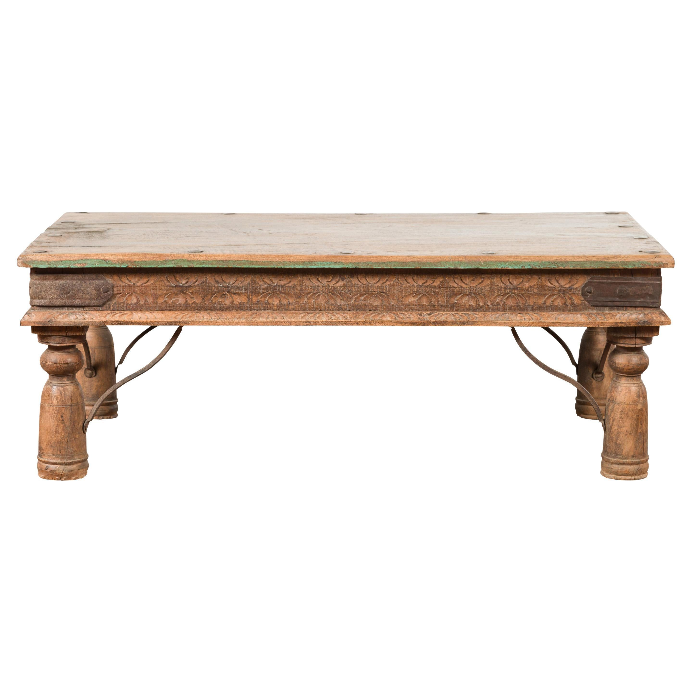 19th Century Indian Rustic Coffee Table with Iron Accents and Carved Apron