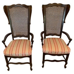 Stylish Pair of Caned Back Armchairs with Wings and Upholstered Seats