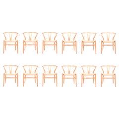 Set of Twelve Midcentury Wishbone Chairs in Patinated Oak by Hans Wegner, 1960s