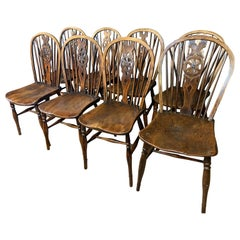 Harlequin Set of Eight 18th Century Windsor Wheel Back Chairs