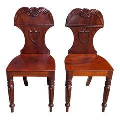 Pair of English Mahogany Shield Back Foliage Crest Hall Chairs, circa 1820