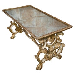 Richly Carved Mirror Top Giltwood Coffee Table, French, nineteenth century.