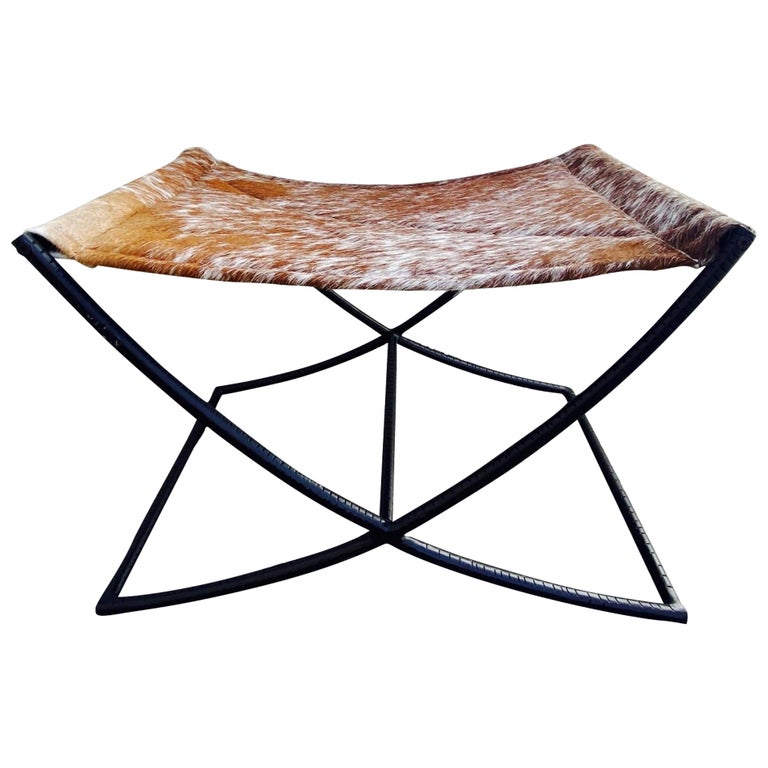Campaign Style Bench with Brown and White Leather Hide Seat and Iron Base For Sale