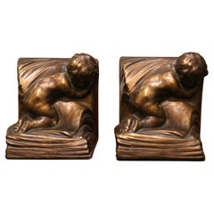 Pair of Patinated Armor Bronze Cherub Bookends Signed and Dated CA Johnson 1914