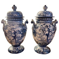 Pair of Blue and White Faience Glazed Lidded Urns