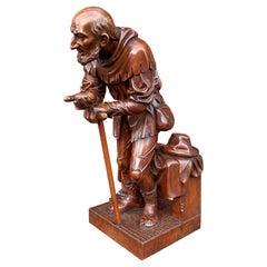 Finest Quality, Antique Hand Carved Nutwood Swiss Black Forest Beggar Sculpture