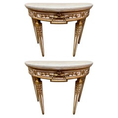 Pair of French Louis XVI Style Carved and Parcel Gilt Consoles with Marble Tops