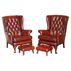 Pair of Restored Chesterfield Wingback Bordeaux Leather Armchairs & Footstools