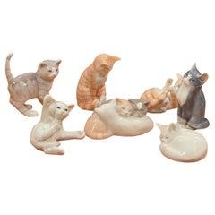 Collection of Seven Miniature Porcelain Cat Sculptures by Royal Copenhagen