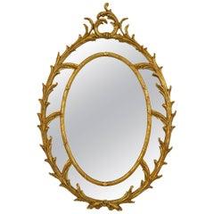 20th Century Italian Rococo Style Wall Mirror in a Double Foliate Giltwood Frame