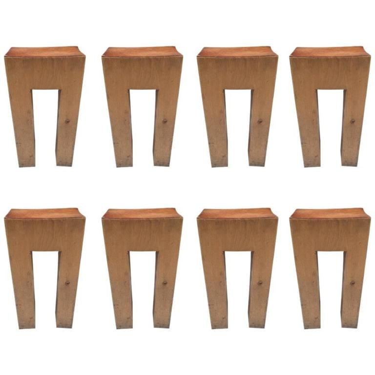 Eight Rare Solid Bar Stools with Leather Seats For Sale