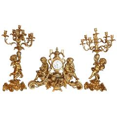Three-Piece French Garniture Set, 19th Century Consists of Clock and Candelabrum