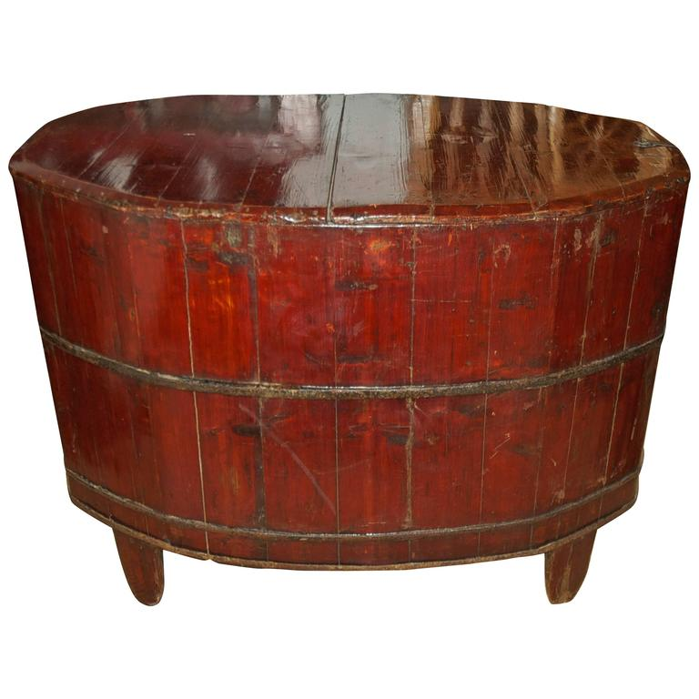 A storage container for rice or wheat in lacquered wood (probably elm) on tapered feet, with lift-top and iron side pulls. China, circa 1800s. Makes a lovely end table and an interesting conversation piece! Measures: 39