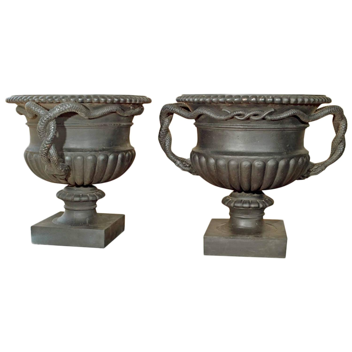 Pair Of Cast Iron Urns With Entwined Serpent Handles For Sale At 1stdibs