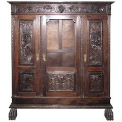 1880s Hand-Carved Figural Cabinet with Claw Feet, Faces and Interior Light