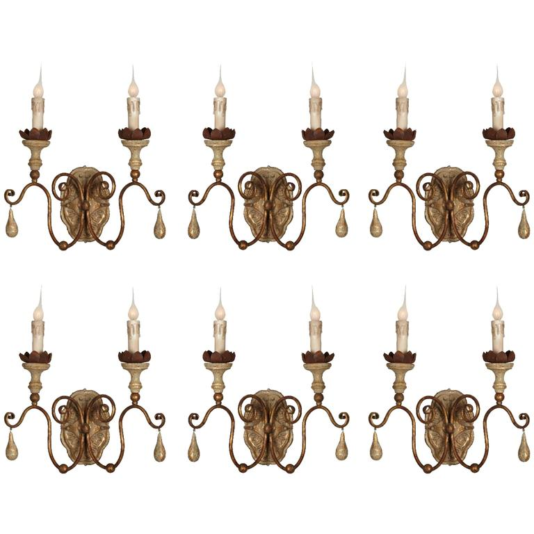Six Two-Arm Italian Style Carved Wood and Tole Sconces with Lovely Worn Patina For Sale