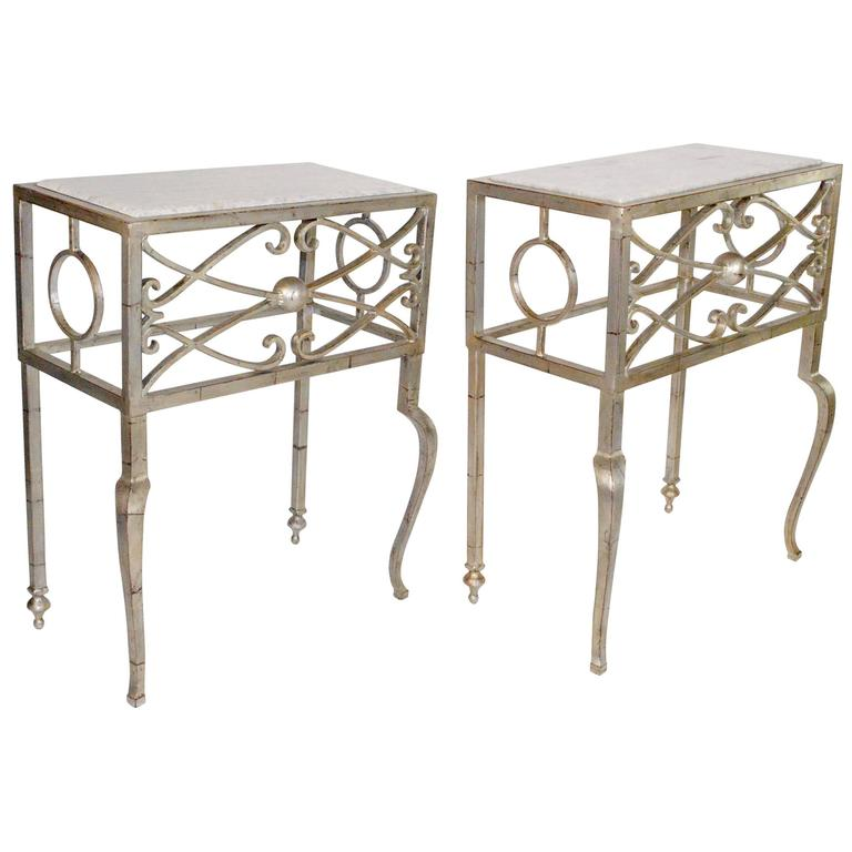 Pair of Marble-Top Deco Style Silver Leafed Steel Consoles