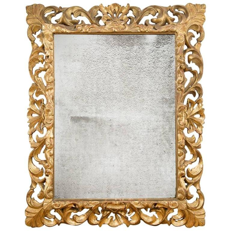 Ornately Carved Gold Giltwood Mirror, France, circa 1830 For Sale