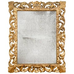 Ornately Carved Gold Giltwood Mirror, France, circa 1830