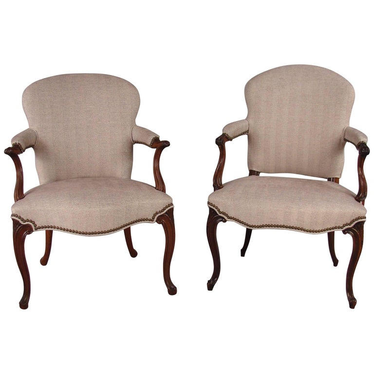 Two Similar Mahogany Georgian Style Armchairs in the French Hepplewhite Taste