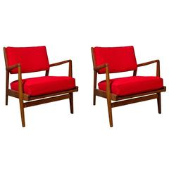 Pair of Jens Risom solid walnut lounge chairs with ottoman