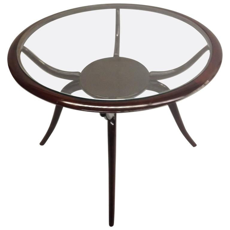 Elegant Italian Mid-Century Arachnid / Spider Form Cocktail table or side table or gueridon by Guglielmo Ulrich.   Ulrich's work was influenced by Art Deco and a Sober Modern neoclassicism, both of which are seen in this delicate, sensuous piece.