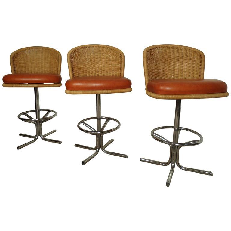 Three Mid-Century Chrome and Wicker Barstools by Daystom