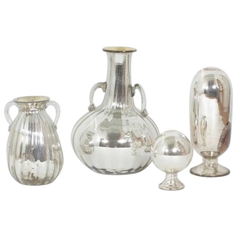 Four Pieces of Mercury Glass