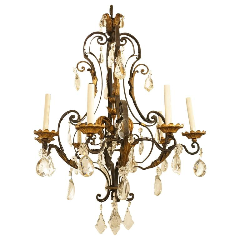Eight-Arm Wrought Iron and Crystal Chandelier with Gilt Highlights