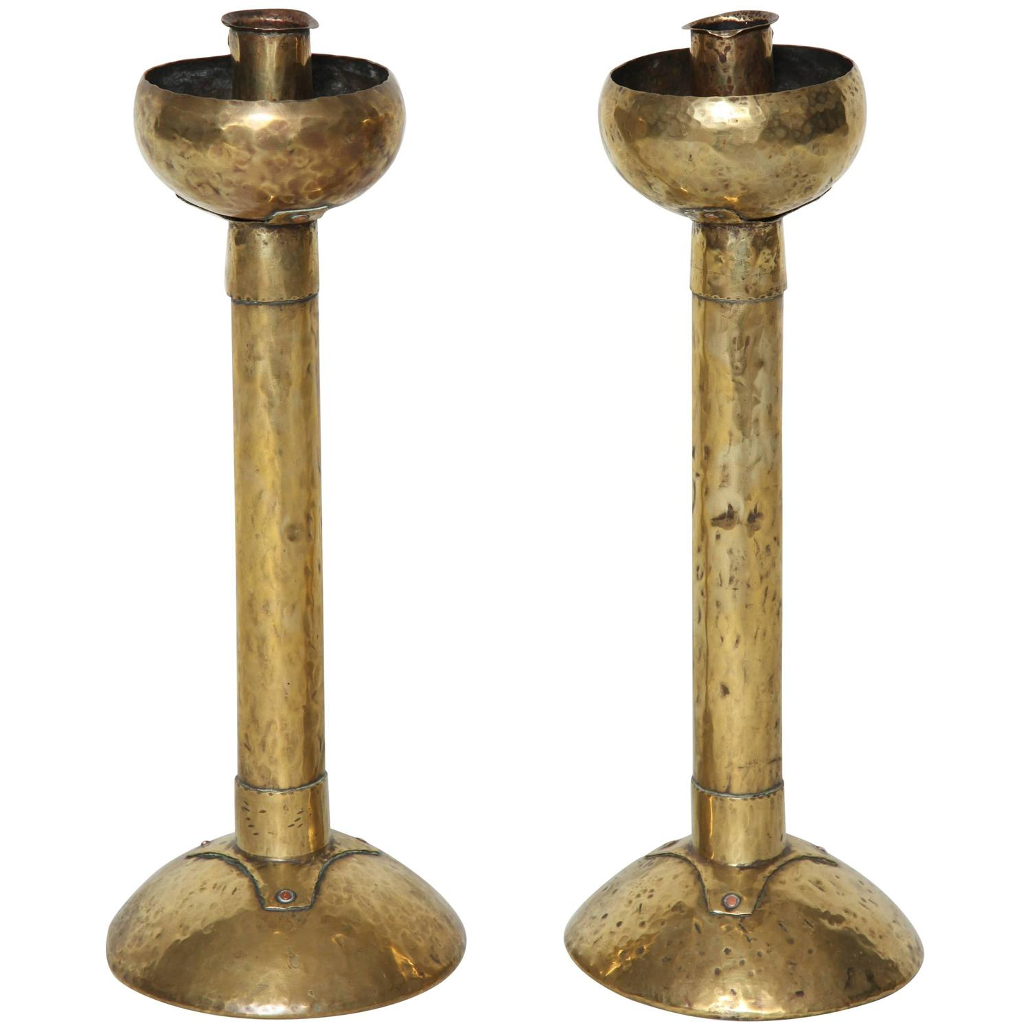 pair of arts and crafts hammered brass candlesticks for