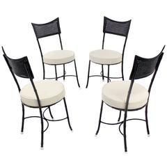 Four Cast Aluminum Faux Bamboo and Cane Round Seat Chairs