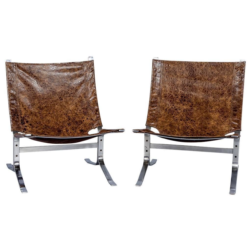 Pair of mid century modern sling chairs in distressed for Mid century modern leather chairs