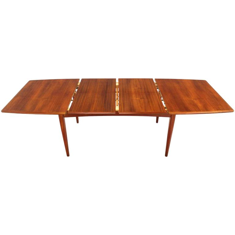 Danish Modern Teak Boat Shape Dining Table with Two Pop-Up Leafs Extension Board