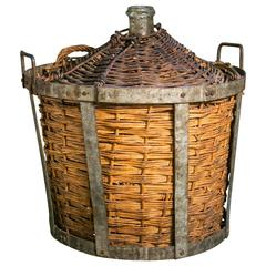 Antique Demi-John in Original Handwoven Rattan and Zinc Basket