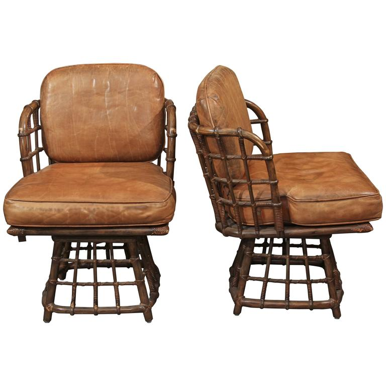 Pair of Maguire Swivel Chairs 1