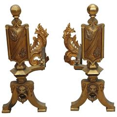 1920s Pair of Gilded French Figural Ornate Bronze Lion Head and Shield Andirons