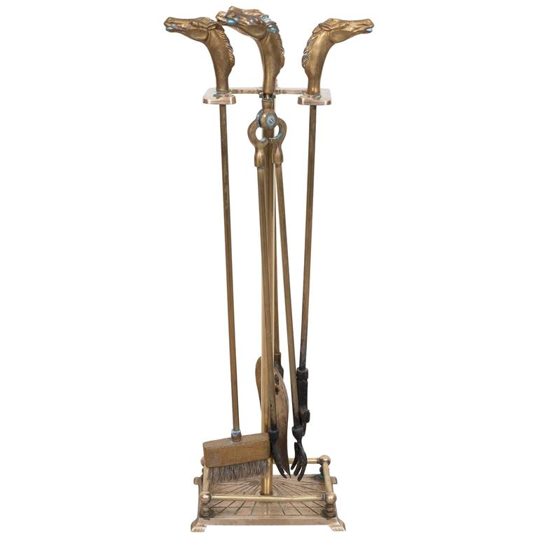 For Sale on 1stdibs - This set of brass fireplace tools