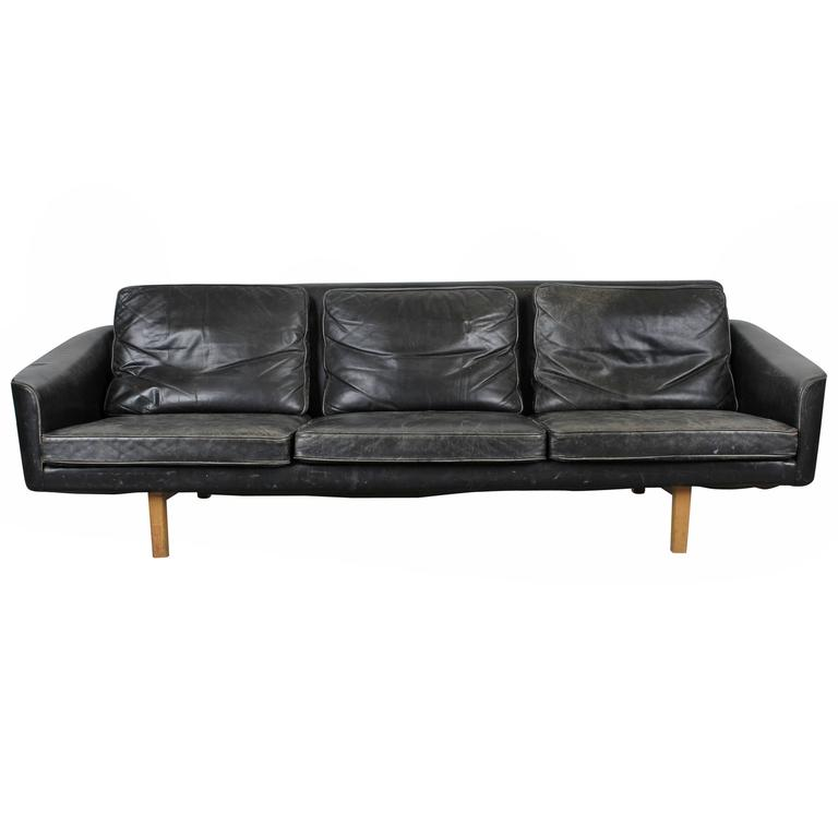 this mid century modern black leather sofa is no longer available