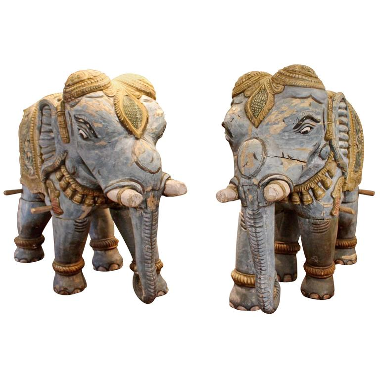 Pair of Parading Polychrome Carved Wood Striding Elephant Sculptures For Sale