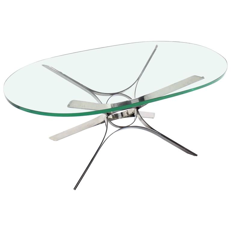 Stainless Steel Ribbon Star Sculpture Base Oval Coffee Table Glass Top For  Sale