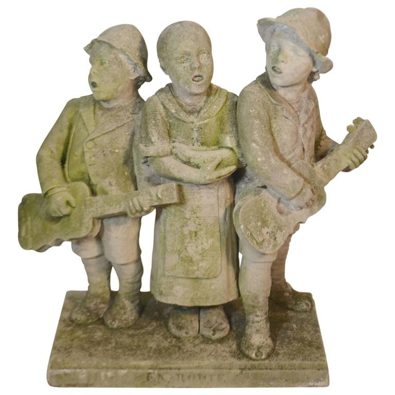 Carved Stone Statue of Children Standing and Singing