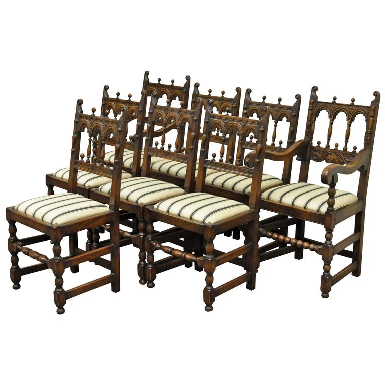 set of eight solid carved oak 1930s jacobean or gothic style
