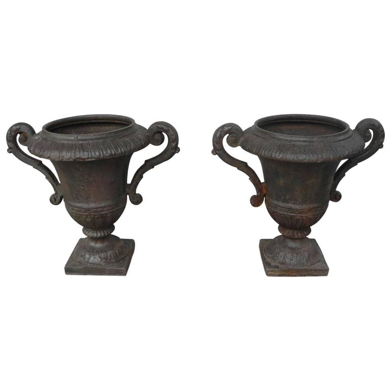 Pair of Antique Iron Urns with Detailing & Carved Arms from 19th Century France
