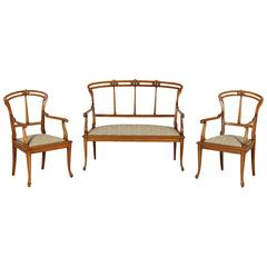 Early 20th Century Liberty Beech Sofa and Two Armchairs